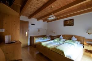 Ein Bett oder Betten in einem Zimmer der Unterkunft Pension Mirandola