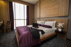 A bed or beds in a room at Active Başaran Business Hotel
