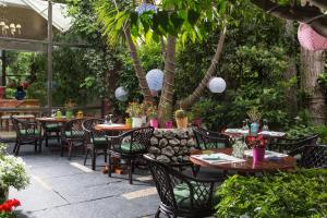 A restaurant or other place to eat at Dionysos Hotel