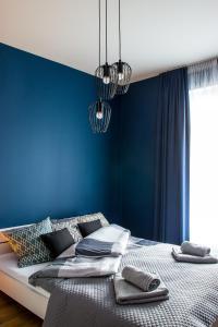 Łóżko lub łóżka w pokoju w obiekcie Cathedral View Apartments