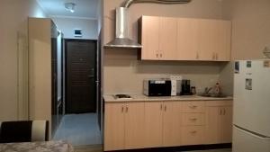 Кухня или мини-кухня в Апартаменты на Лысой Горе