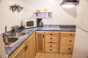 A kitchen or kitchenette at Casa Rural La Barquilla