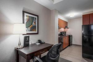 A kitchen or kitchenette at Regency Suites Hotel