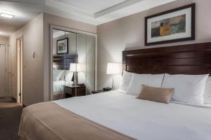 A bed or beds in a room at Regency Suites Hotel
