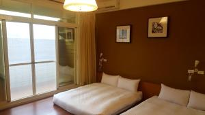 A bed or beds in a room at Outdoor Sports Guest House