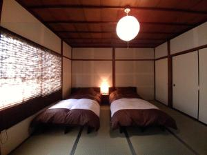 A bed or beds in a room at Yanaka no Taisuke