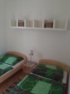 Postel nebo postele na pokoji v ubytování Chata u řeky