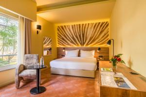 A bed or beds in a room at Calheta Beach - All-inclusive - Savoy Signature