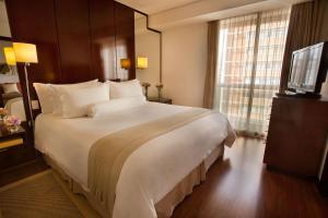 Cama ou camas em um quarto em Etoile Hotels Itaim