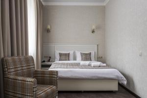 Кровать или кровати в номере Отель Дэтоль