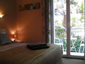 Un ou plusieurs lits dans un hébergement de l'établissement Hotel Mucrina