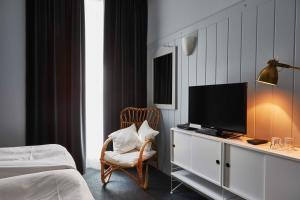 A television and/or entertainment center at Hotel Monterosa