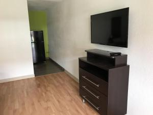 A television and/or entertainment center at Studio 6-Merced, CA