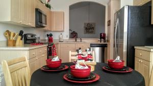 A kitchen or kitchenette at Kissimmee Area Pool Home