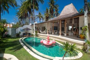 The swimming pool at or near De'Coco Villa and Suites