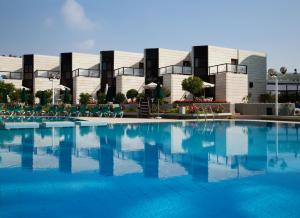 The swimming pool at or near Isrotel Riviera Club