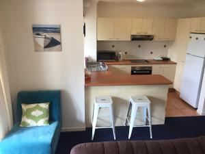 A kitchen or kitchenette at Gold Coast Family Apartment