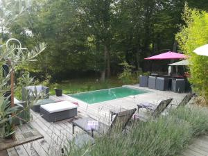 The swimming pool at or near B&B Loft Trotters