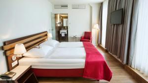 Ein Bett oder Betten in einem Zimmer der Unterkunft Austria Trend Hotel beim Theresianum Wien