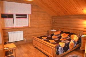 Кровать или кровати в номере Гостевой дом Купеческий