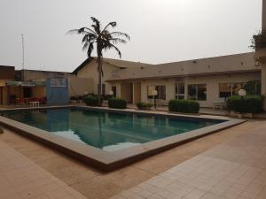 The swimming pool at or near Relax Hotel