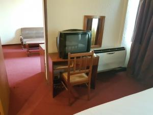 A television and/or entertainment center at Relax Hotel