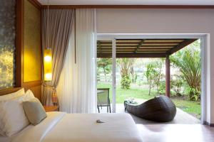 A bed or beds in a room at Beyond Resort Khaolak - Adults Only