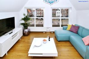 A seating area at Luxury Apartment Delft VI Royal View