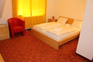 A bed or beds in a room at Hotel City Residence