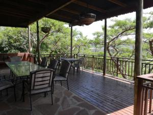 A balcony or terrace at Thorn Tree Lodge & Conference Centre