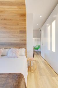 Un ou plusieurs lits dans un hébergement de l'établissement Look Barcelona Apartment