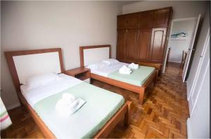 Cama ou camas em um quarto em Copacabana Posto 6
