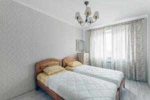 A bed or beds in a room at Апартаменты у ФОК Салют