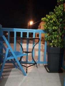 A balcony or terrace at Angelos Rooms