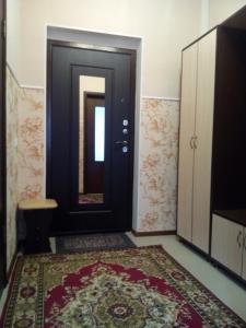 """Кровать или кровати в номере 1-к квартира ЖК """"Азимут"""""""