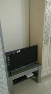 "A television and/or entertainment center at ""Малая Земля"" (Проспект Ленина/ Героев Десантников)"
