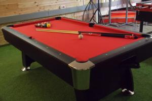A pool table at Hostel Colours