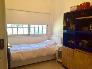 Una cama o camas en una habitación de Casa Miraflores Kachuk