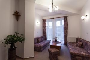 Posezení v ubytování Hotel Adršpach Garni