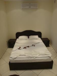 Family Hotel Niagara tesisinde bir odada yatak veya yataklar