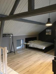 A bed or beds in a room at The Cottage and The Loft