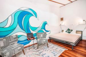 A bed or beds in a room at Selina Puerto Viejo
