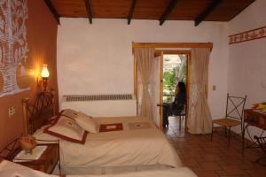 A bed or beds in a room at Hotel Divisadero Barrancas