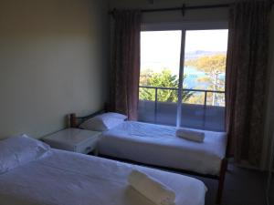 A bed or beds in a room at Kooringa 12