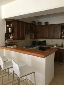 Una cocina o zona de cocina en Cancun House Apartment - Isla Dorada