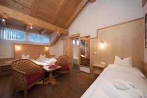 Ein Bett oder Betten in einem Zimmer der Unterkunft Hotel Garni Passeier