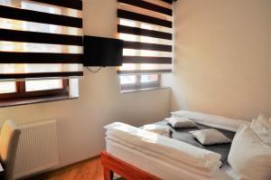Krevet ili kreveti u jedinici u objektu Hotel Noble
