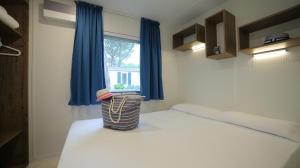 Postel nebo postele na pokoji v ubytování Camping Waikiki