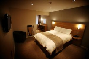 A bed or beds in a room at Eaton Hotel