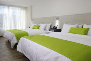 A bed or beds in a room at Arame Hotel